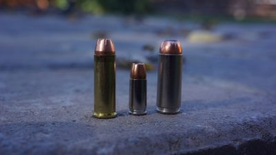 The .50 AE cartridge (right), next to a 9mm (center) and a .44 Mag. (left).