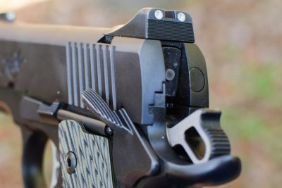 Note the extended beaver tail grip safety and tritium rear sight unit.