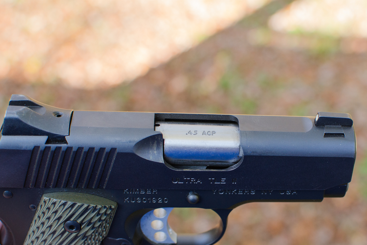 The pistol features a flattop slide and factory night sights.