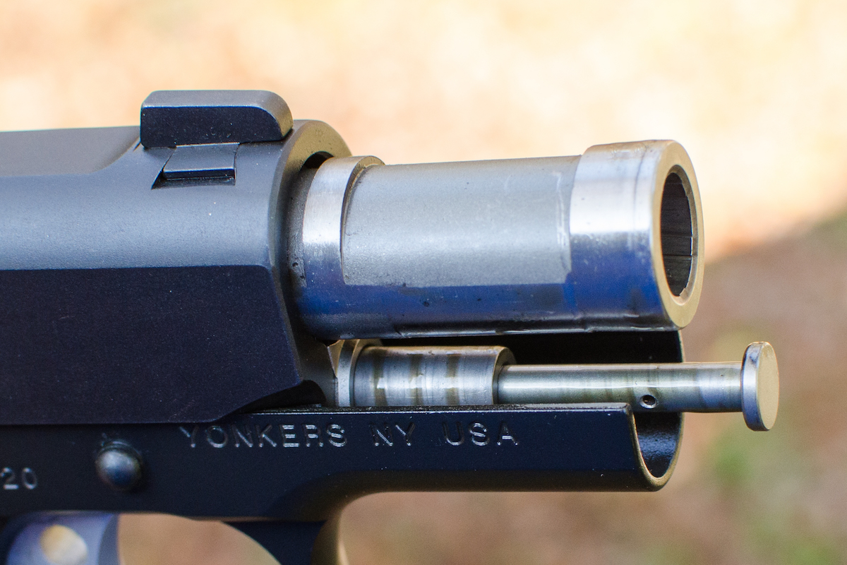The pistol employs a telescoping recoil spring assembly due to the short length of the slide and barrel.