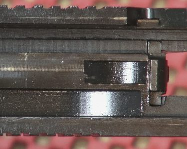 The 1911P is a Series-70 pistol, as noted by the absence of a firing pin safety block.