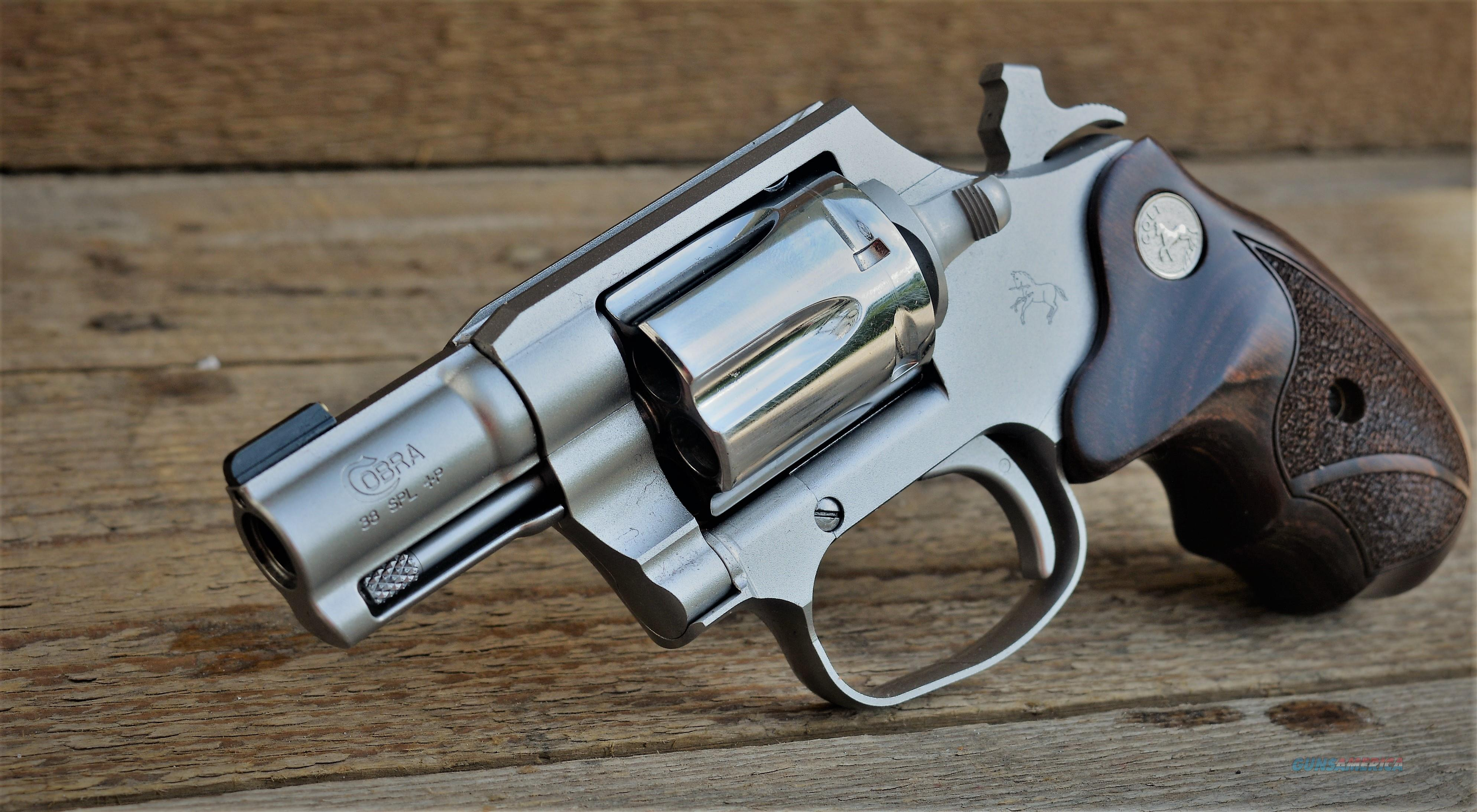 $69 Colt Cobra Conceal & Carry Wood Medallion Grips High Polish 38 Spl+P Revolver  Double action Hammer Pulls Back for smooth Shooting stainless steel frame Brass Bead COBRASC2BB  Guns > Pistols > Colt Double Action Revolvers- Modern
