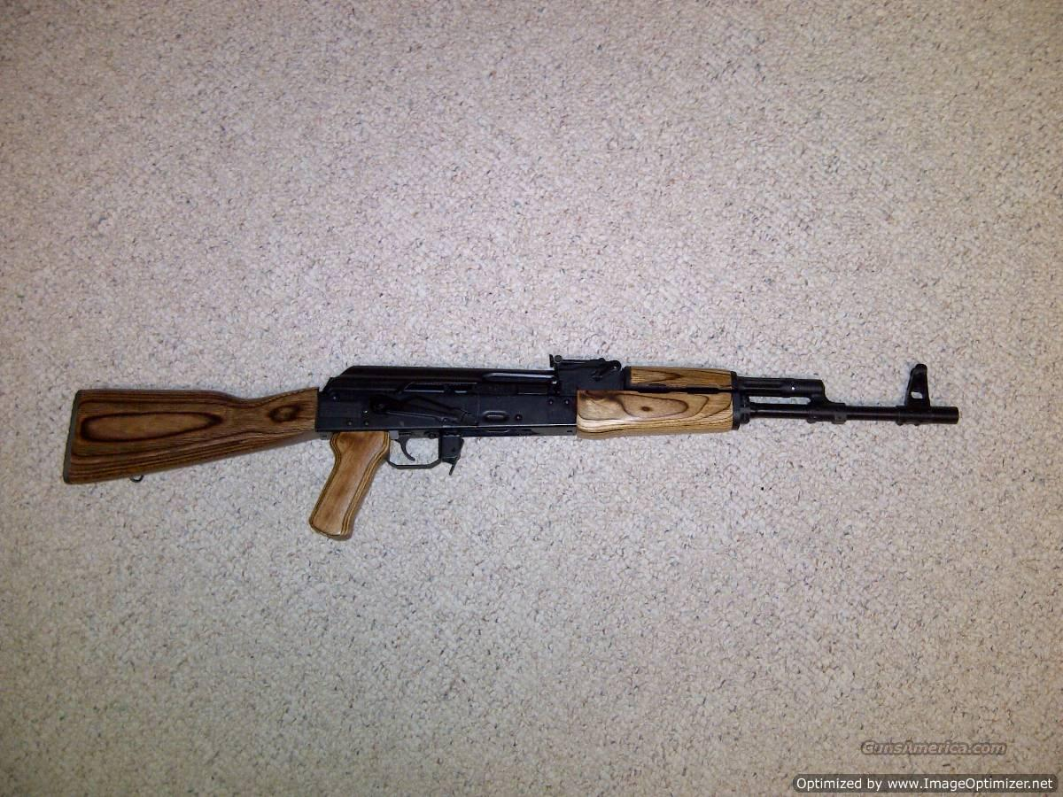 AK47, NEW, IZHMASH of Russia, Saiga, With Brown Laminate Timbersmith Wood Stock and Hand Guard, 7.62 x39mm, with Tapco G2 Trigger Group, Hogue Pistol Grip, and (30) Round Magazine...   Guns > Rifles > AK-47 Rifles (and copies) > Full Stock