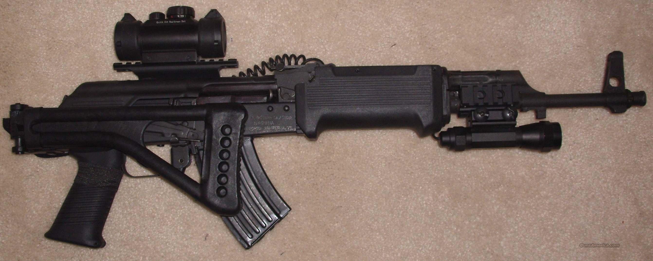 AK47 w/ tactical stock, reticle, laser sight, and tac light