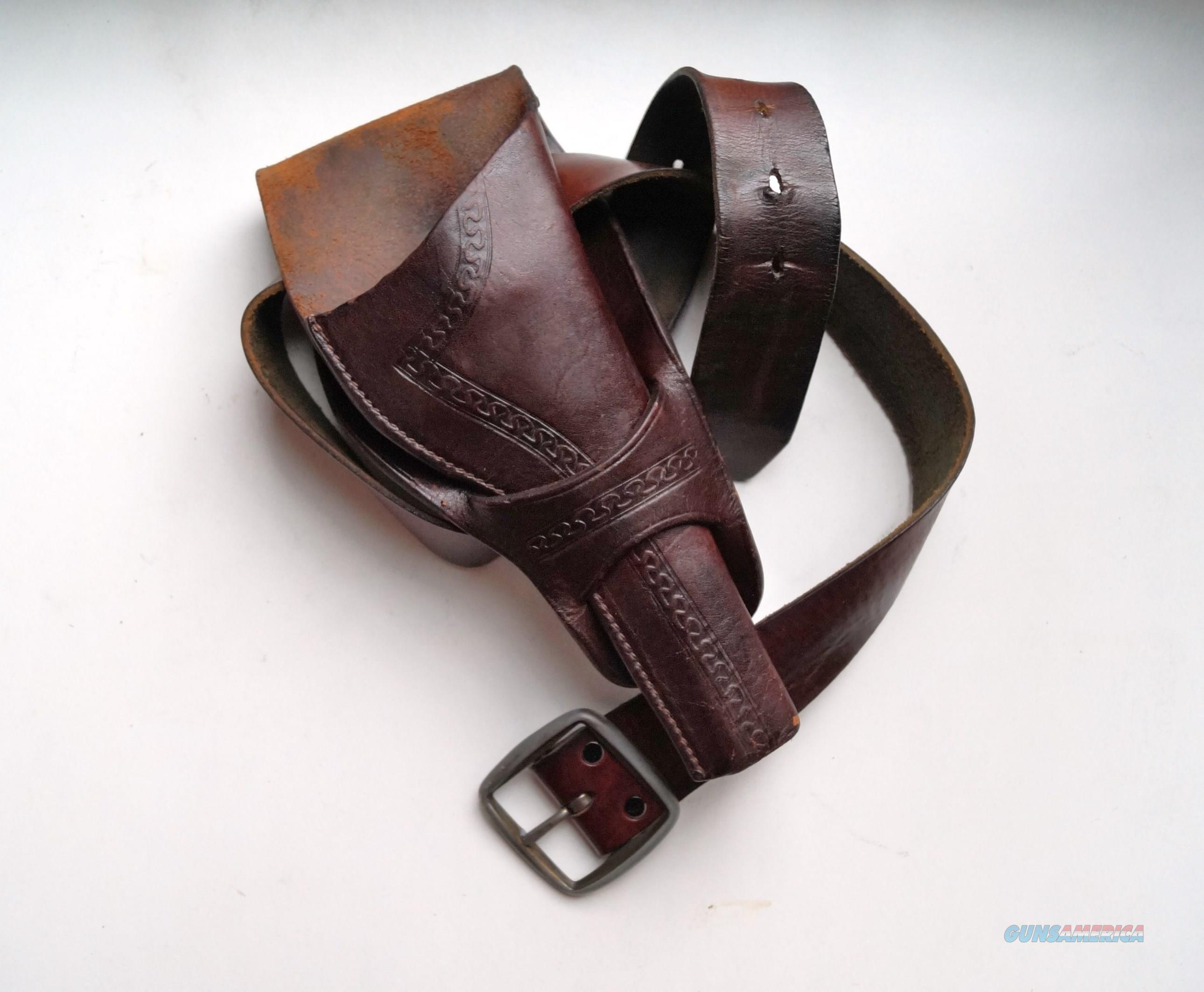 ENGRAVED LEATHER HOLSTER FOR A COLT SAA REVOLVER  Non-Guns > Holsters and Gunleather > Cowboy