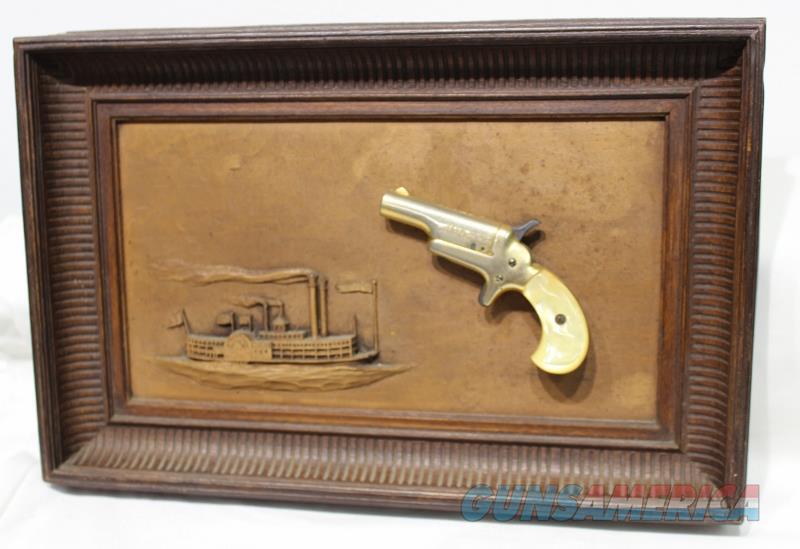 Colt Derringer in picture non firing 22 short gold plate  Non-Guns > Artwork