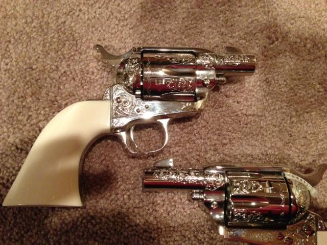 COLT SHERIFF'S MODELS, TWO, CONSECTUTIVE SERIAL NUMBERS AND ENGRAVED.  FACTORY ENGRAVED COLT .45 SHERIFF'S MODELS. B ENGRAVED BY COLT EXPERT ENGRAVER.  ONE PICE IVORY GRIPS, NICKEL .  Guns > Pistols > Colt Single Action Revolvers - 3rd Gen.