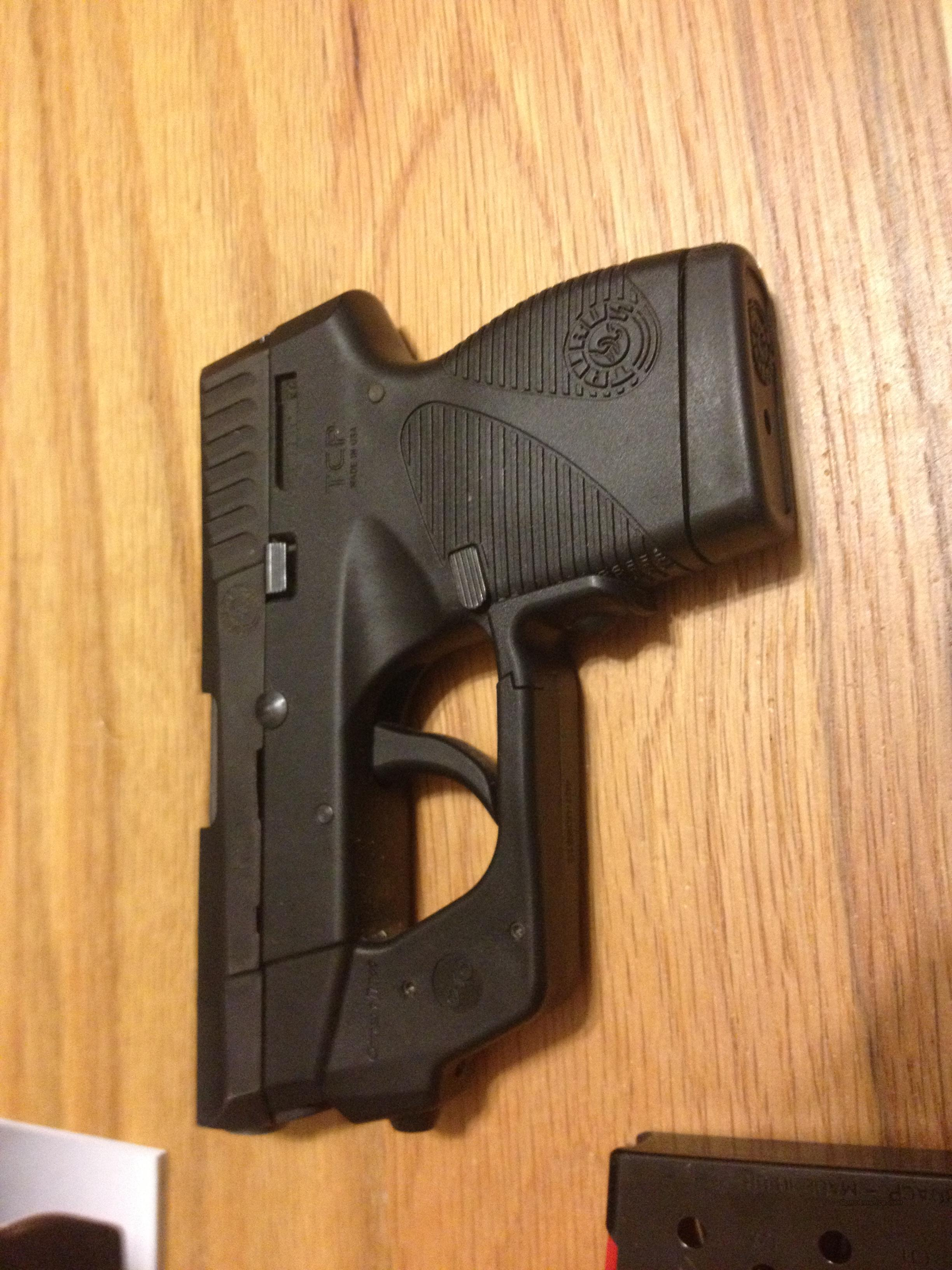 Taurus TCP PT738 in .380acp w/Crimson Trace Laser Grips installed  738 Like New in case  Guns > Pistols > Taurus Pistols/Revolvers > Pistols > Polymer Frame