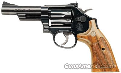 "Smith & Wesson (NEW) Model 15, .38 Special 4"" Barrel, Blue finish, carbon steel frame & cylinder, checkered wood grip, adj. rear sight SKU #150716  Guns > Pistols > Smith & Wesson Revolvers > Full Frame Revolver"