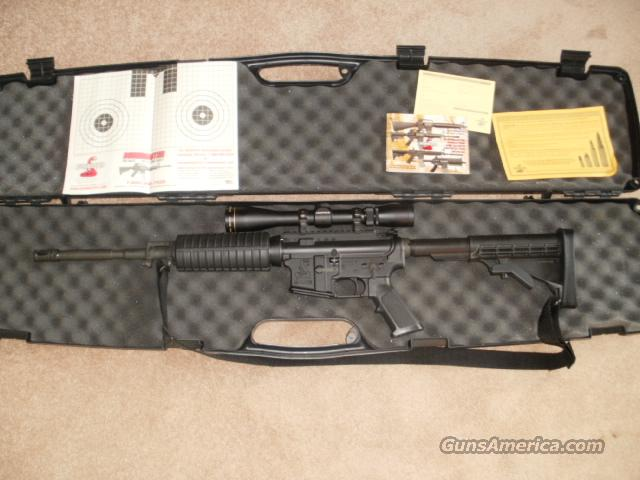 Bushmaster EM-15 Carbine w/ Leupold scope  Guns > Rifles > Bushmaster Rifles > Complete Rifles