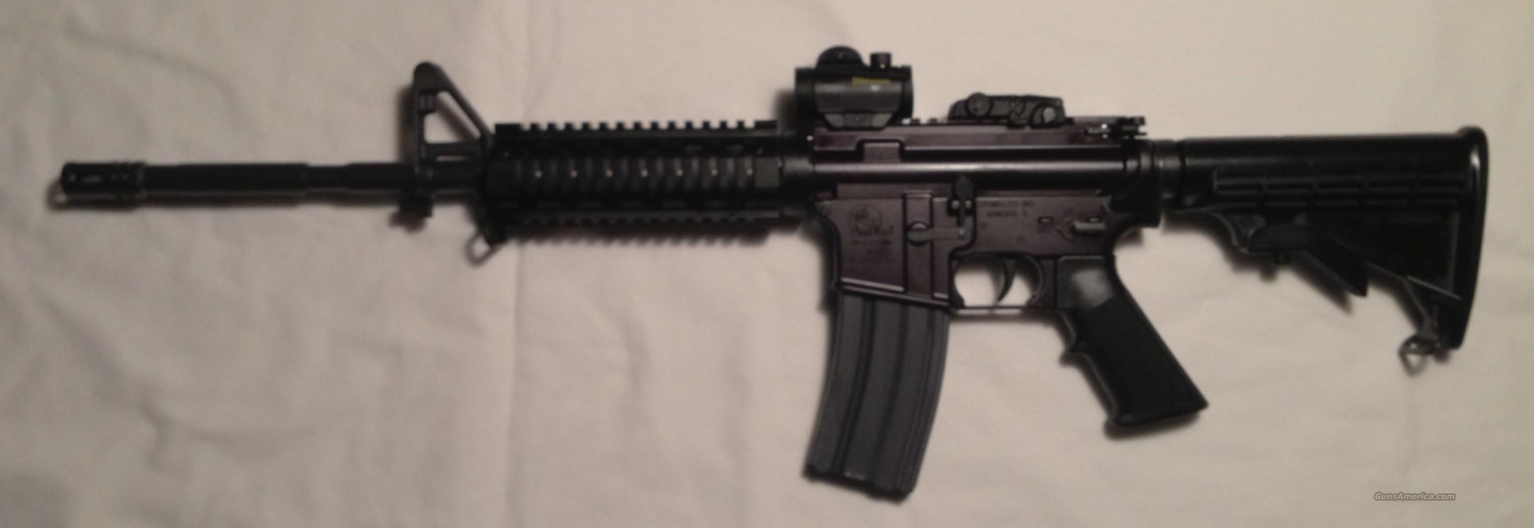Tired of Clones!  NIB Armalite M15A4 LE Carbine + Quad rail forend + Bushnell Red Dot + 3 30 round mags + Backup sight  Guns > Rifles > Armalite Rifles > Complete Rifles