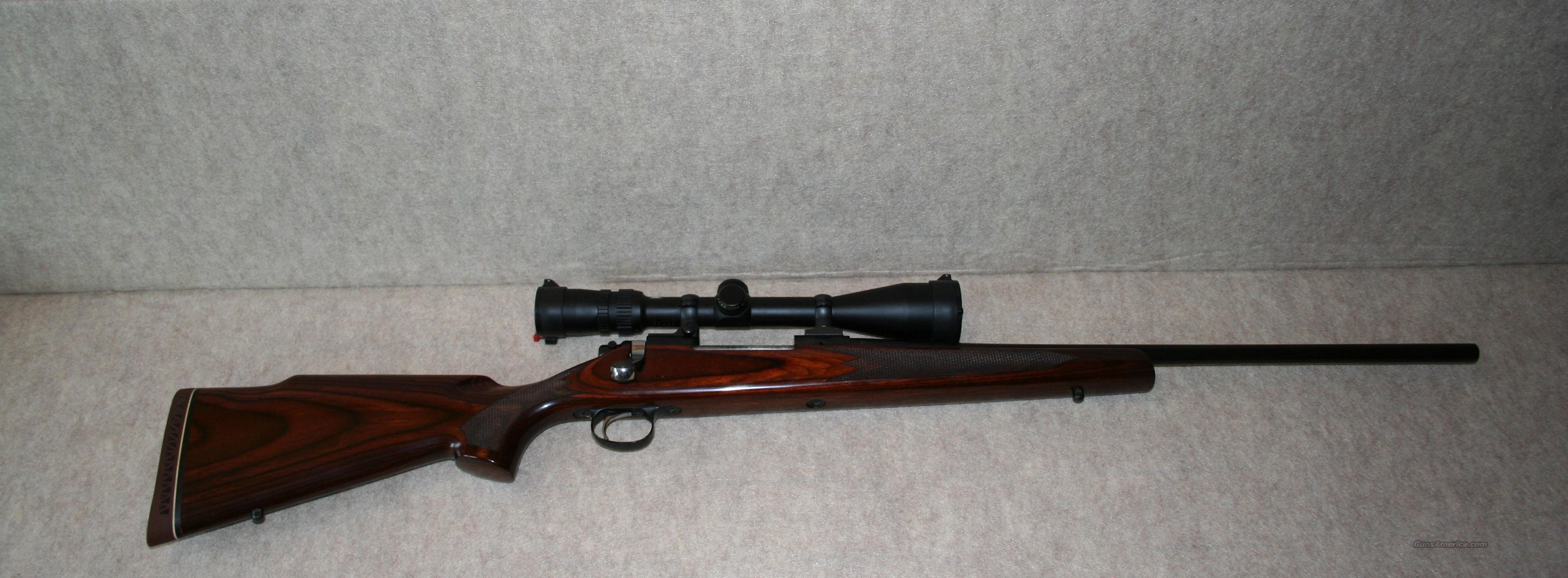 700 Deluxe Factory Laminated Stock 30-06 with Scope  Guns > Rifles > Remington Rifles - Modern > Model 700 > Sporting