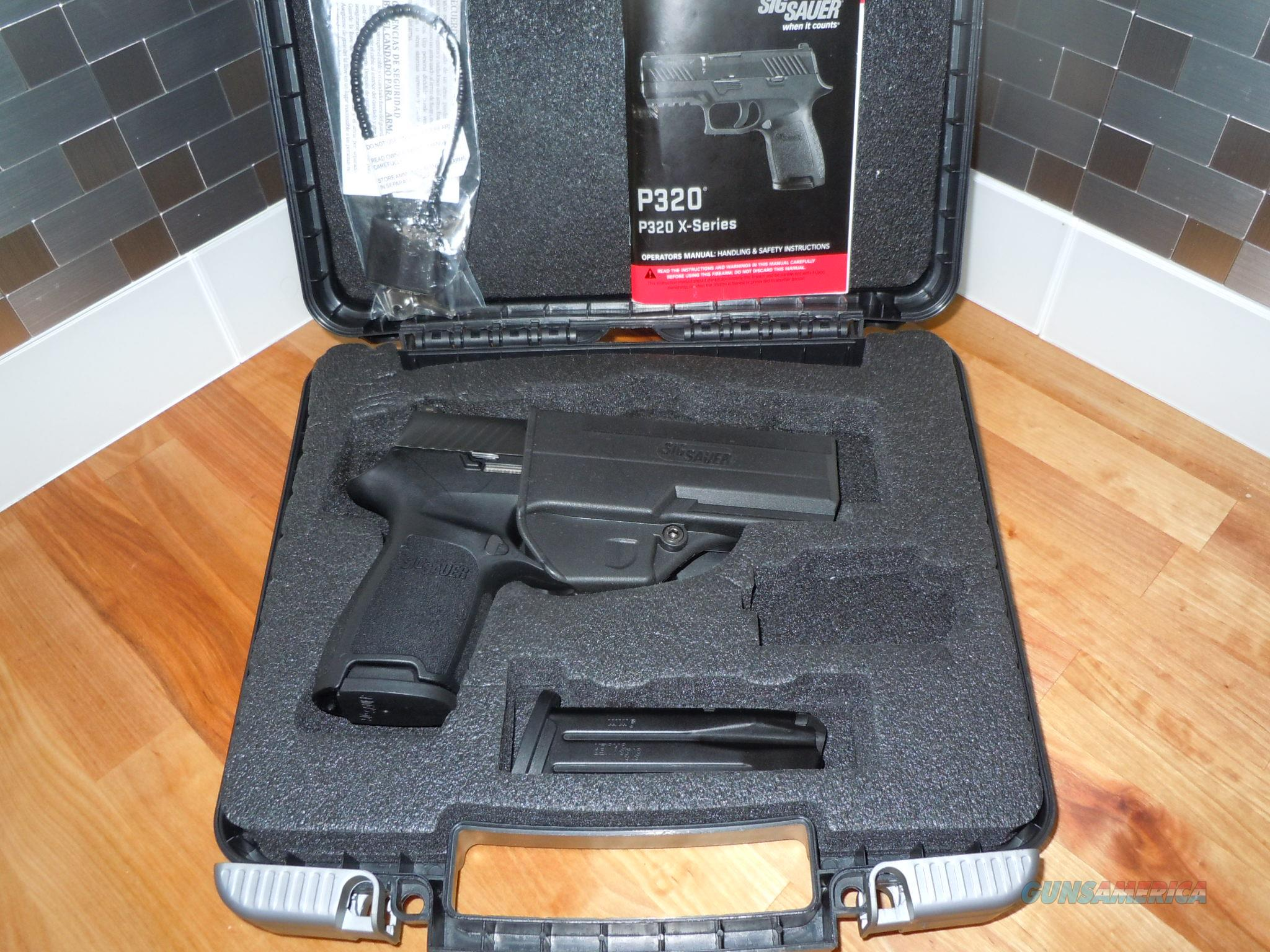 Sig Sauer P320c X-series 9mm Nitron 2-15rnd Mags Fired once by me.   Guns > Pistols > Sig - Sauer/Sigarms Pistols > P230