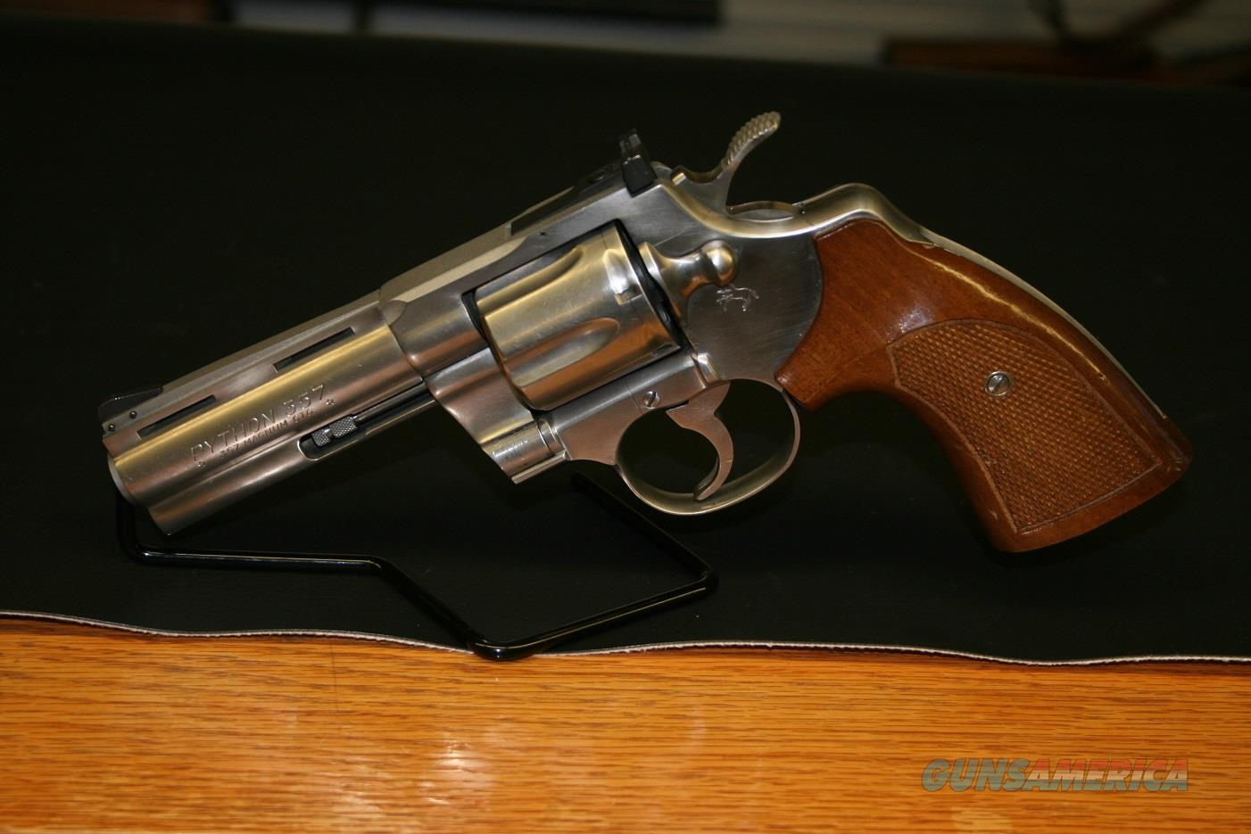 Colt Python 357 Magnum, 4in Vent Rib Barrel, 6 shot, Ramped Front Sight, Adjustable Rear Sight, Stainless Steel Finish, Walnut Grips  Guns > Pistols > Colt Double Action Revolvers- Modern