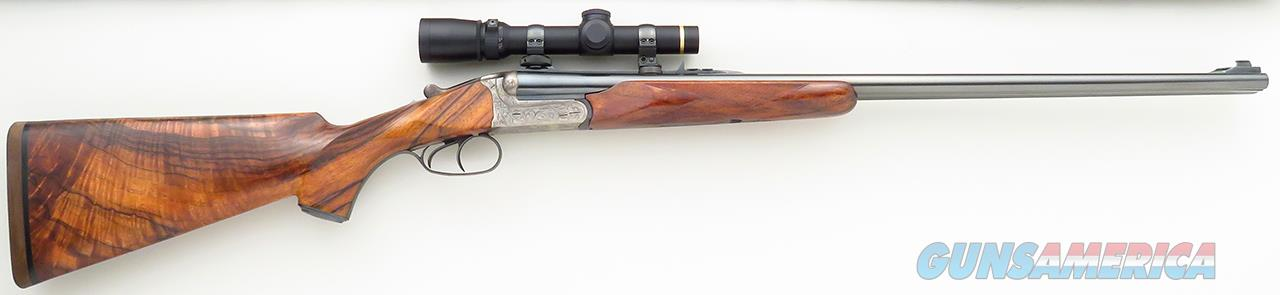 Rigby .225 Winchester double rifle, ejectors, engraved, gold accents, English walnut, Leupold, 99% condition  Guns > Rifles > Rigby Rifles