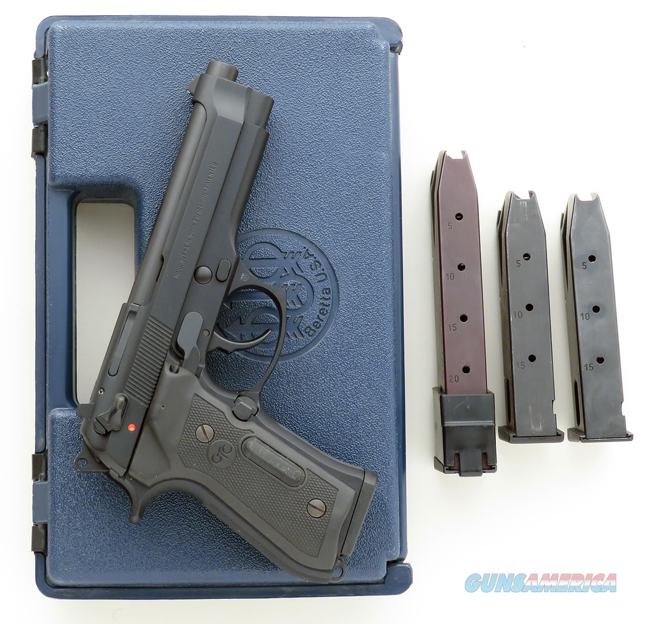 Beretta 92F 9mm, Crimson Trace Lasergrips, three 15-round & one 20-round factory magazines, case  Guns > Pistols > Beretta Pistols > Model 92 Series