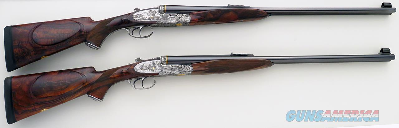 Left hand pair of Dumoulin sidelock double rifles in .375 H&H and .470 NE, game scene engraved, unfired  Guns > Rifles > D Misc Rifles