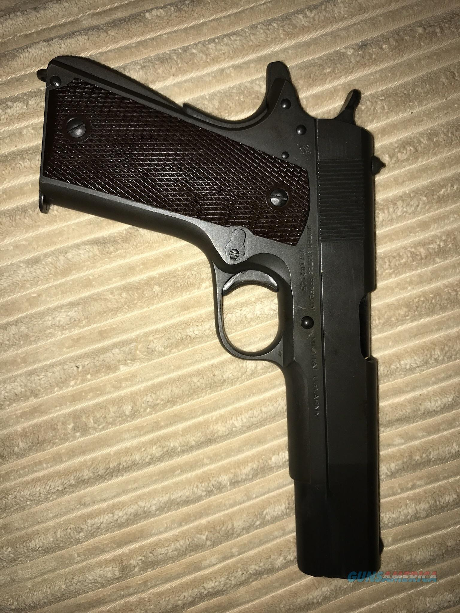 Colt 1911 , WWll issue parkerized finish, pretty good shape, have a mag but not original WWll issue mag.  Guns > Pistols > Collectible Pistols