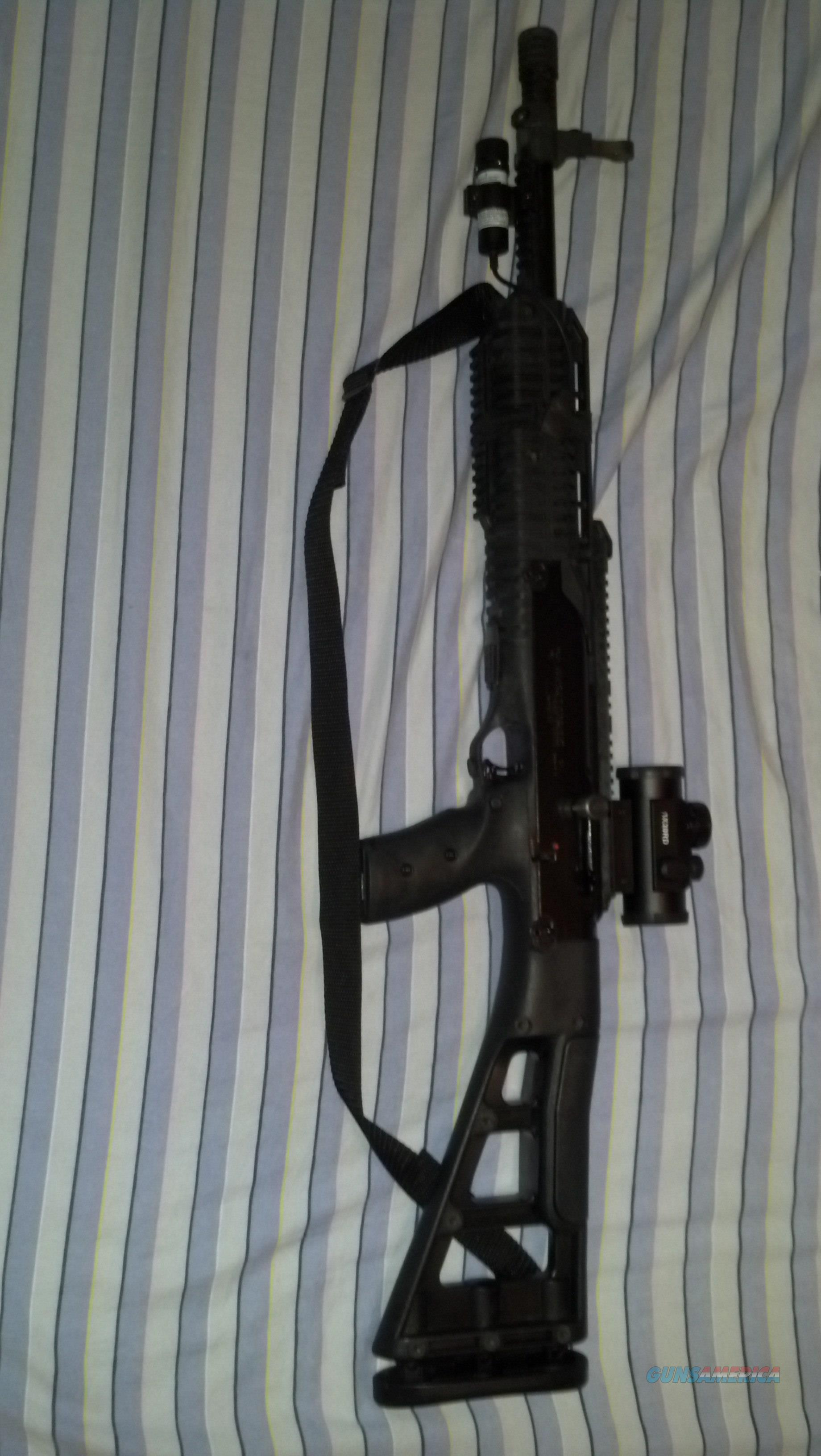 9 millimeter Hi Point rifle with with laser and scope with red or green. Comes with two 10-round clips and original sites  Guns > Rifles > Hi Point Rifles