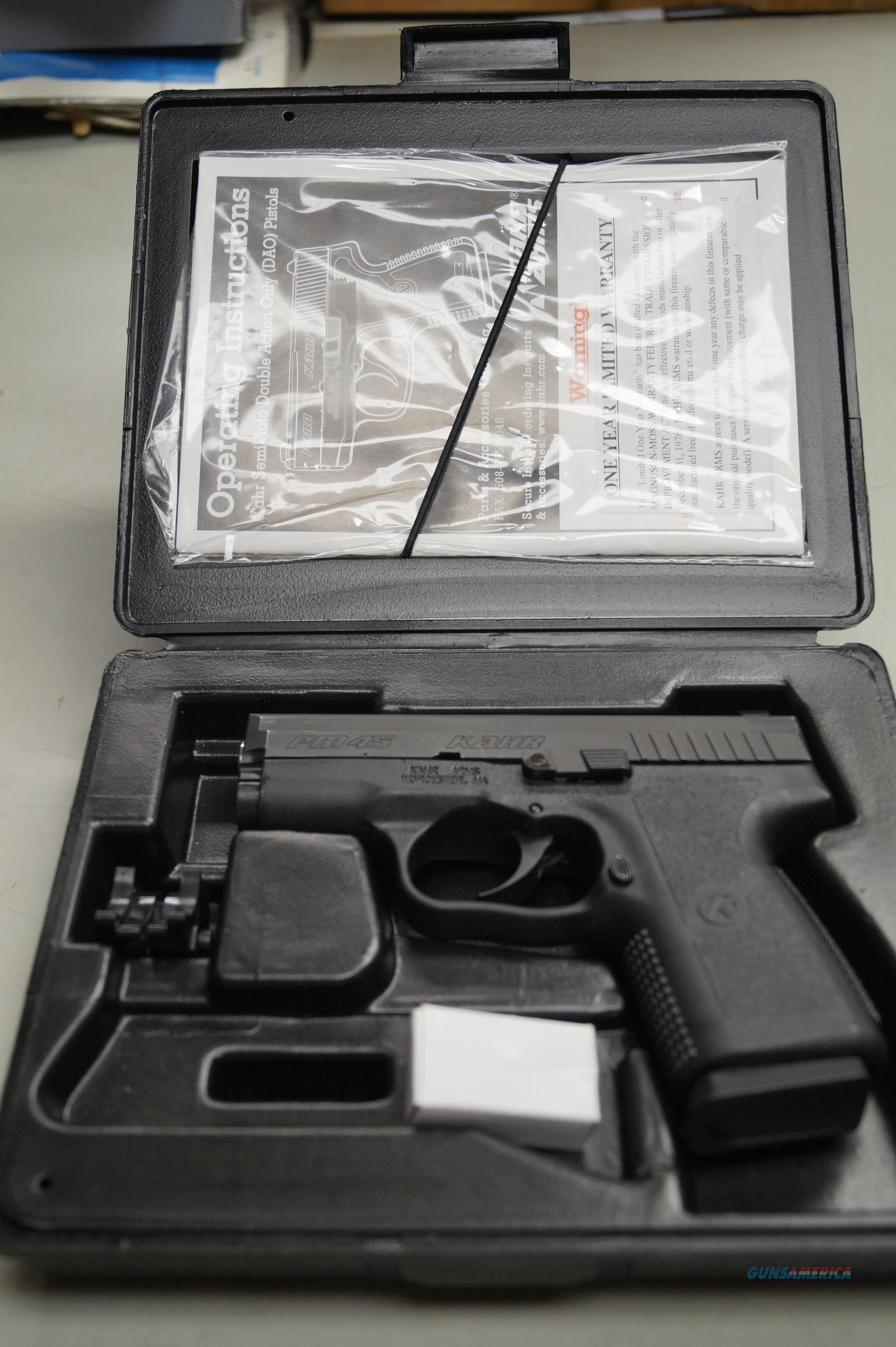 KAHR ARMS  KAHR PM 45  45 ACP STAINLESS STEEL BLUE PISTOL WITH BOX AND ALL PAPERS  Guns > Pistols > Kahr Pistols
