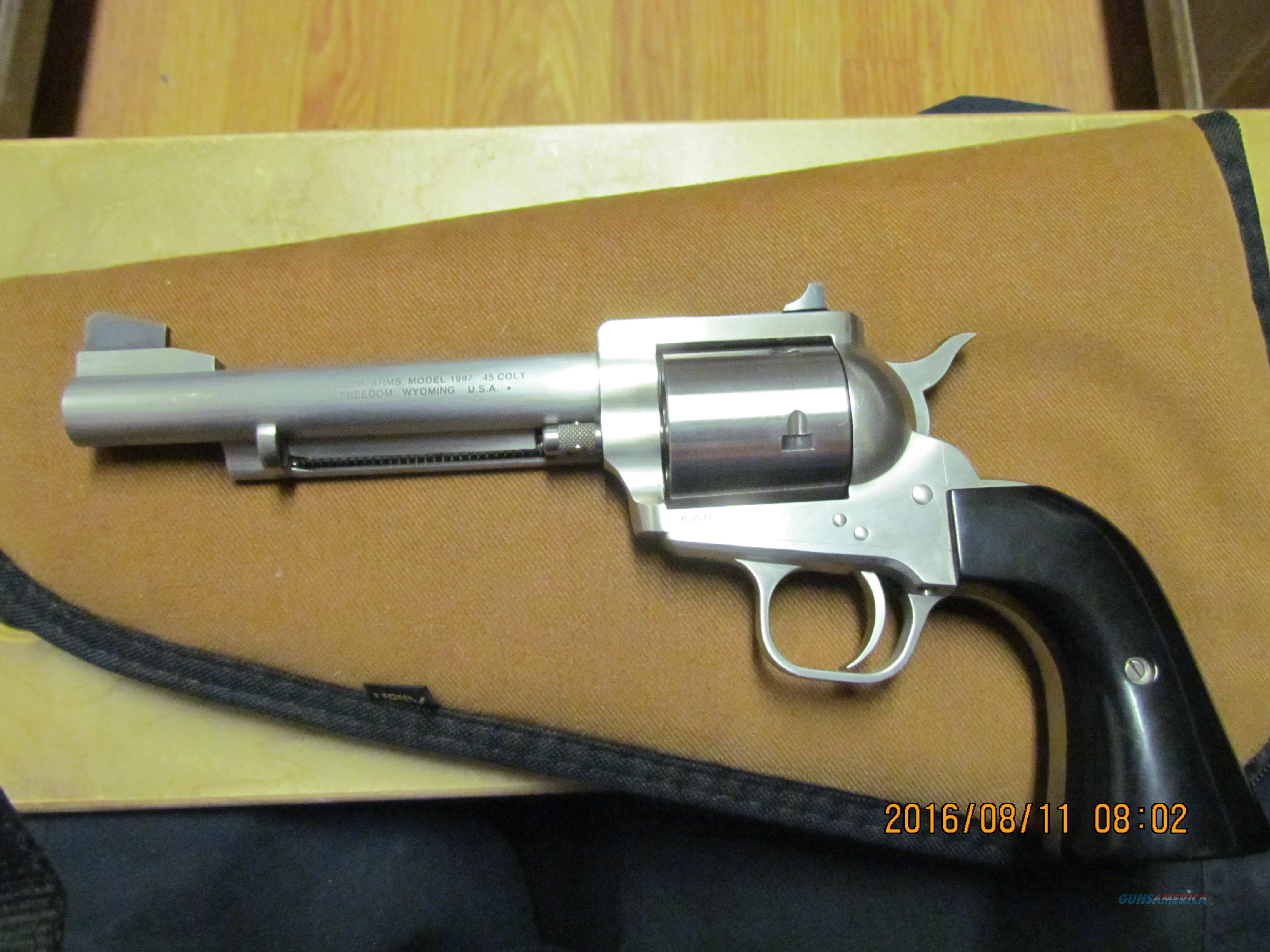 "Freedom Arms Model 97 45 Colt 5 1/2"" Barrel w/Black Micarta Grips in box w/snap caps & lock  Guns > Pistols > Freedom Arms Pistols"