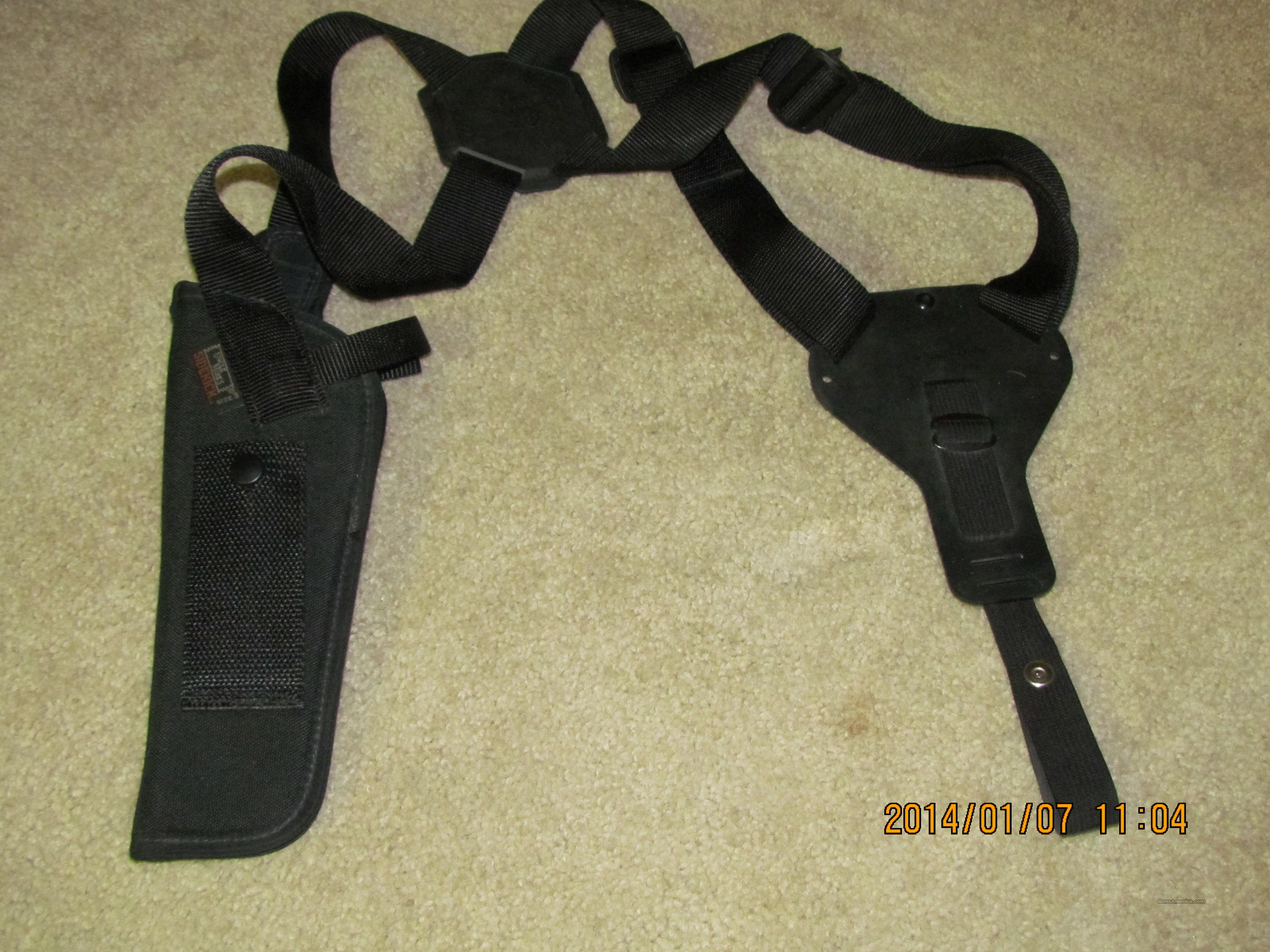 """Uncle Mike's Sidekick Verticle Shoulder Holster Verticle Size 0  Right hand Double Action Revolver 2-3"""" barrel  Non-Guns > Holsters and Gunleather > Shoulder Holsters"""