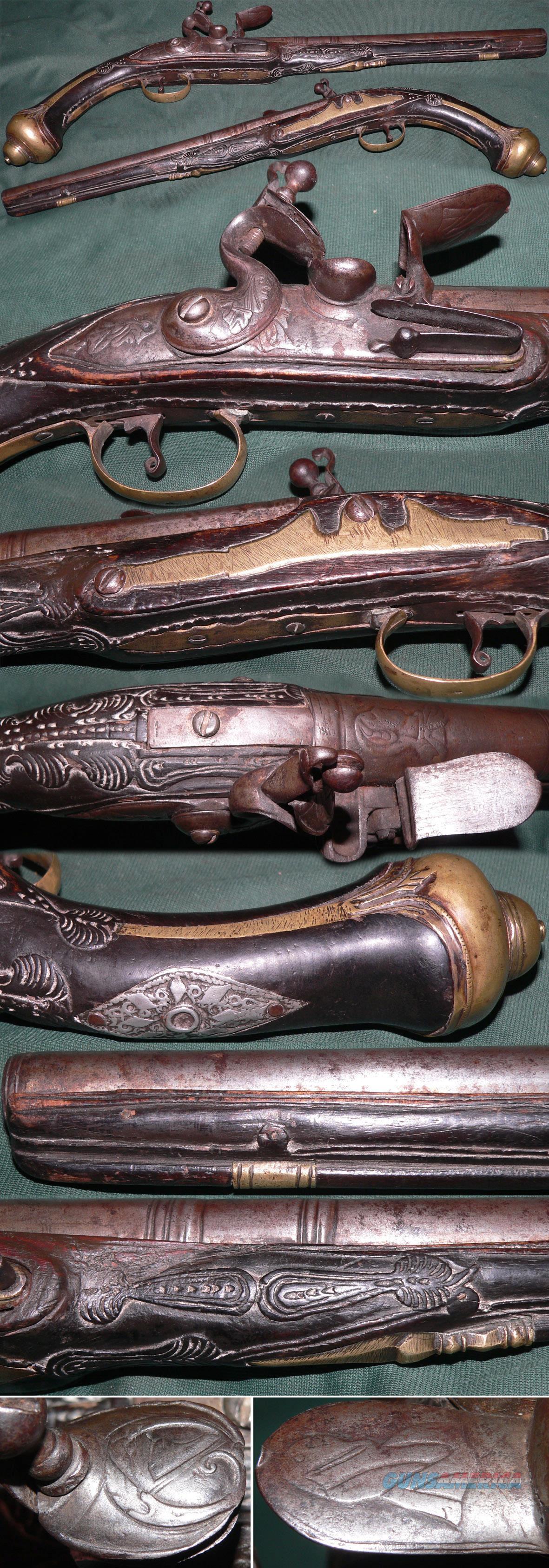flintlock Mediterranean pistol with 6 human faces  Guns > Pistols > Muzzleloading Pre-1899 Pistols (flint)