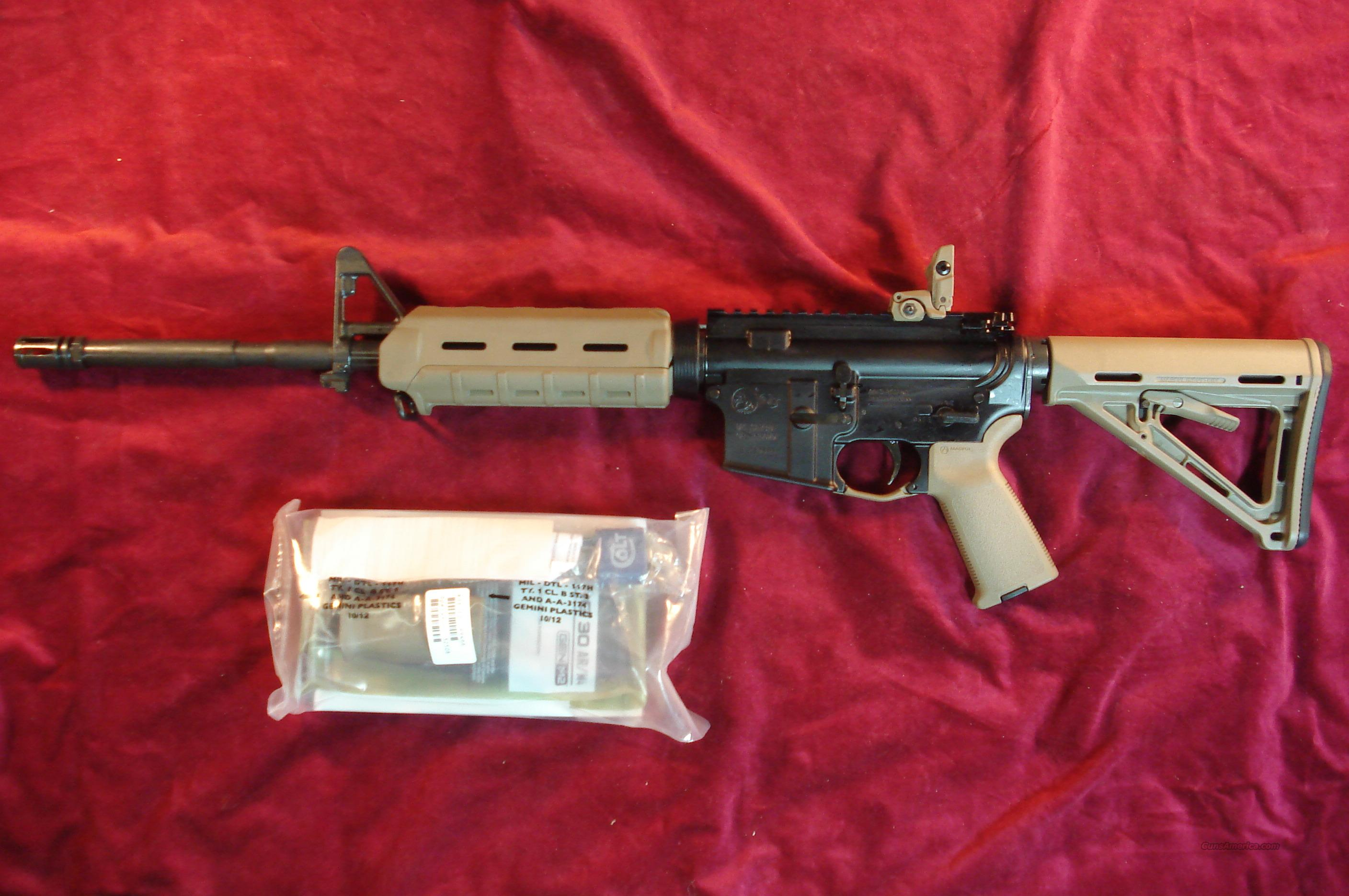 COLT M4 LE6920 2013 CONFIG. FLATTOP FLAT DARK EARTH MAGPUL EQUIPPED AR-15 5.56/223 CAL. NEW (LE6920MP-FDE)   Guns > Rifles > Colt Military/Tactical Rifles