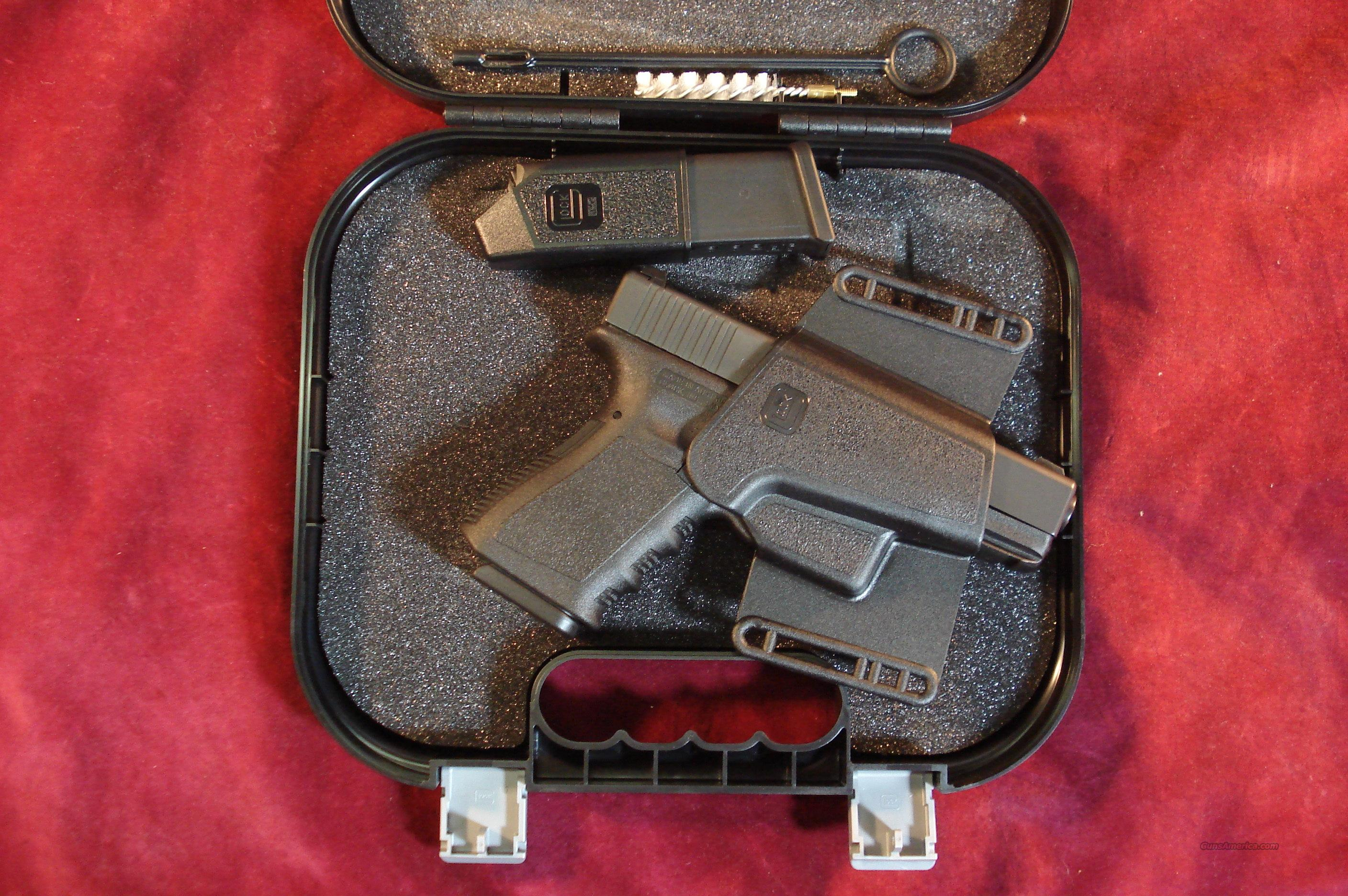 GLOCK 23 W/GLOCK NIGHT SIGHTS AND GLOCK COMBAT HOLSTER TWO 10 ROUND MAGS NEW  Guns > Pistols > Glock Pistols > 23