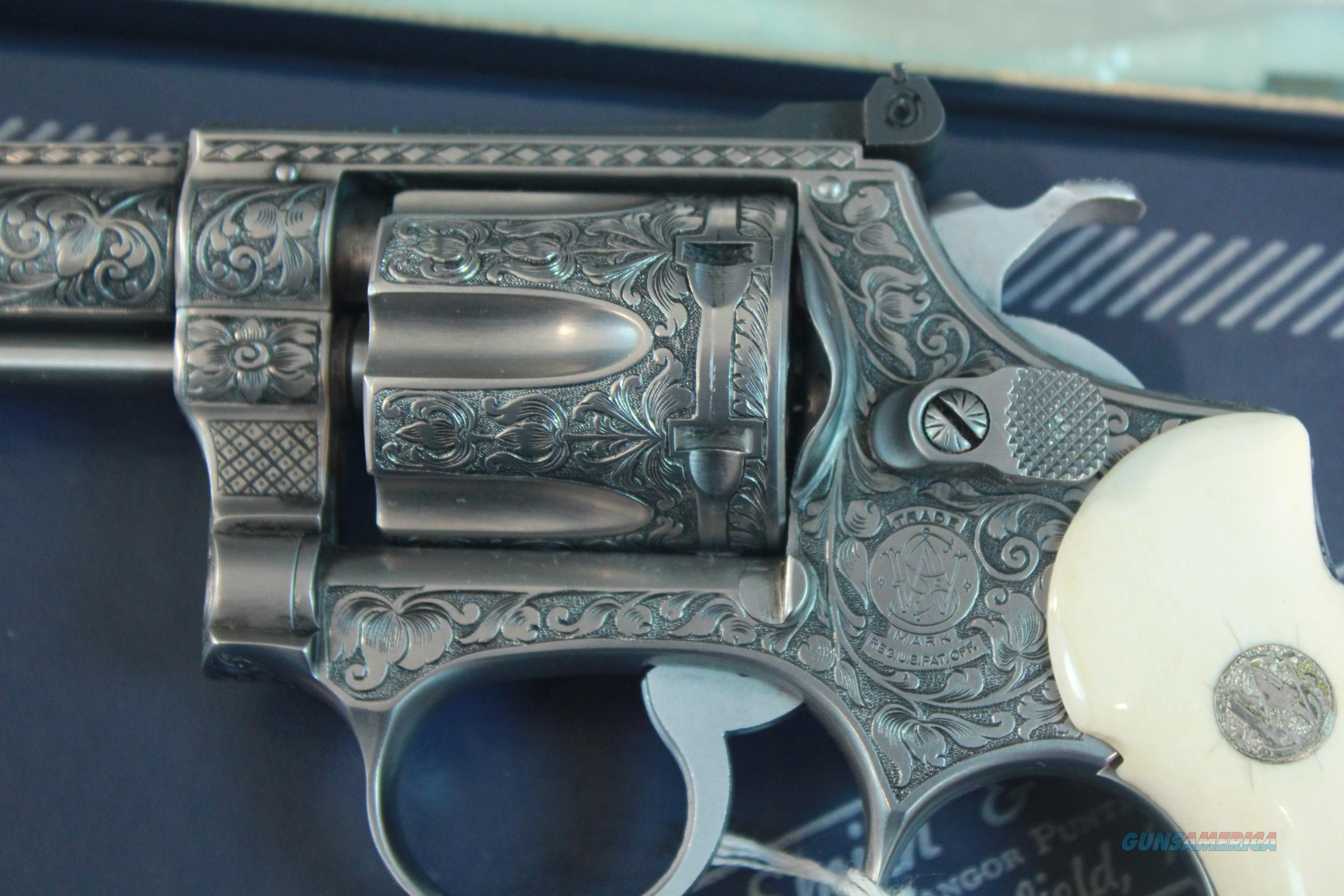 Smith & Wesson Model 63 .22lr Stainless Steel, deep fully engraved, genuine Elephant Ivory Grips with Original Box  Guns > Pistols > Smith & Wesson Revolvers > Pocket Pistols