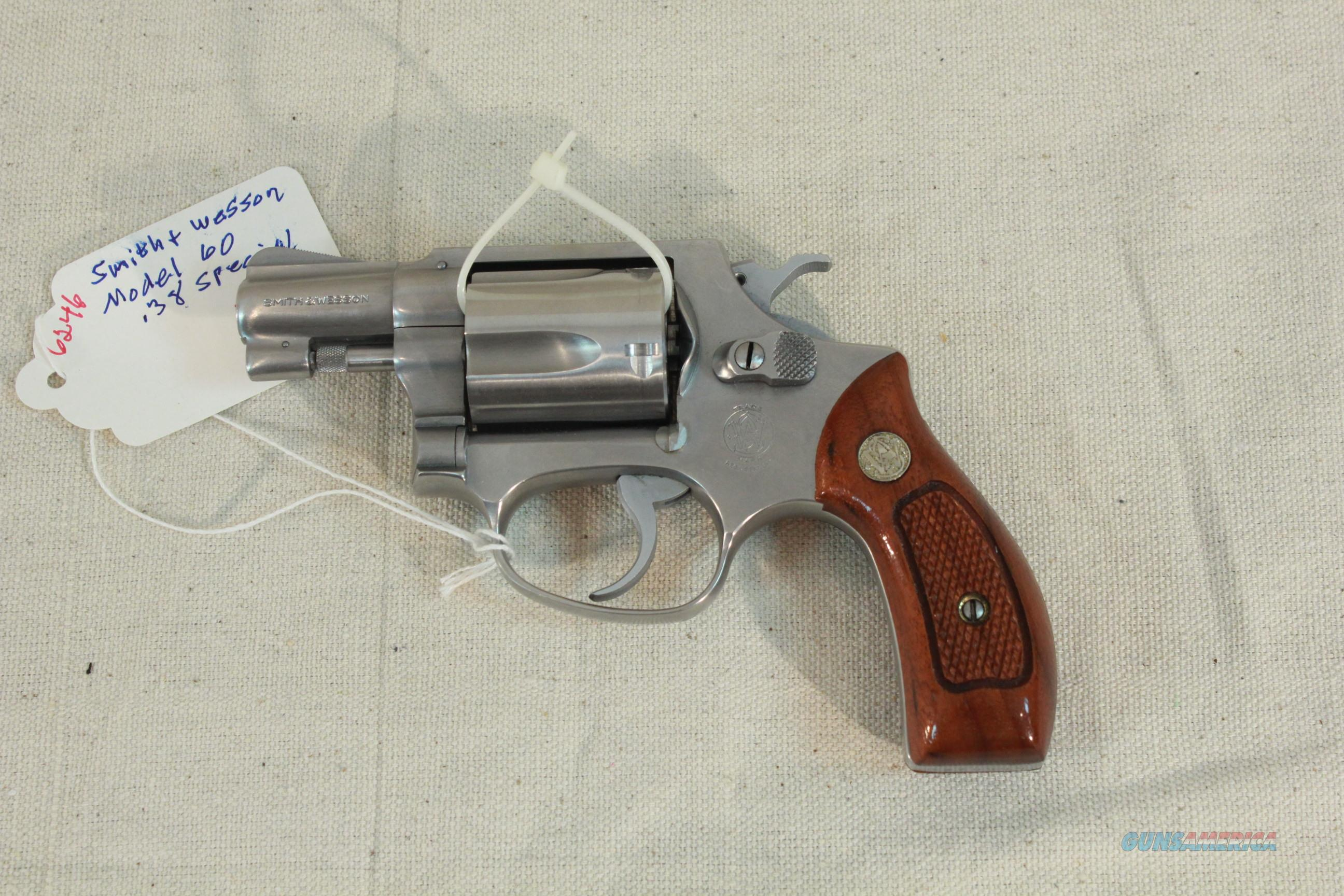Early Smith & Wesson Model 60 with pinned barrel, wood grips  Guns > Pistols > Smith & Wesson Revolvers > Pocket Pistols