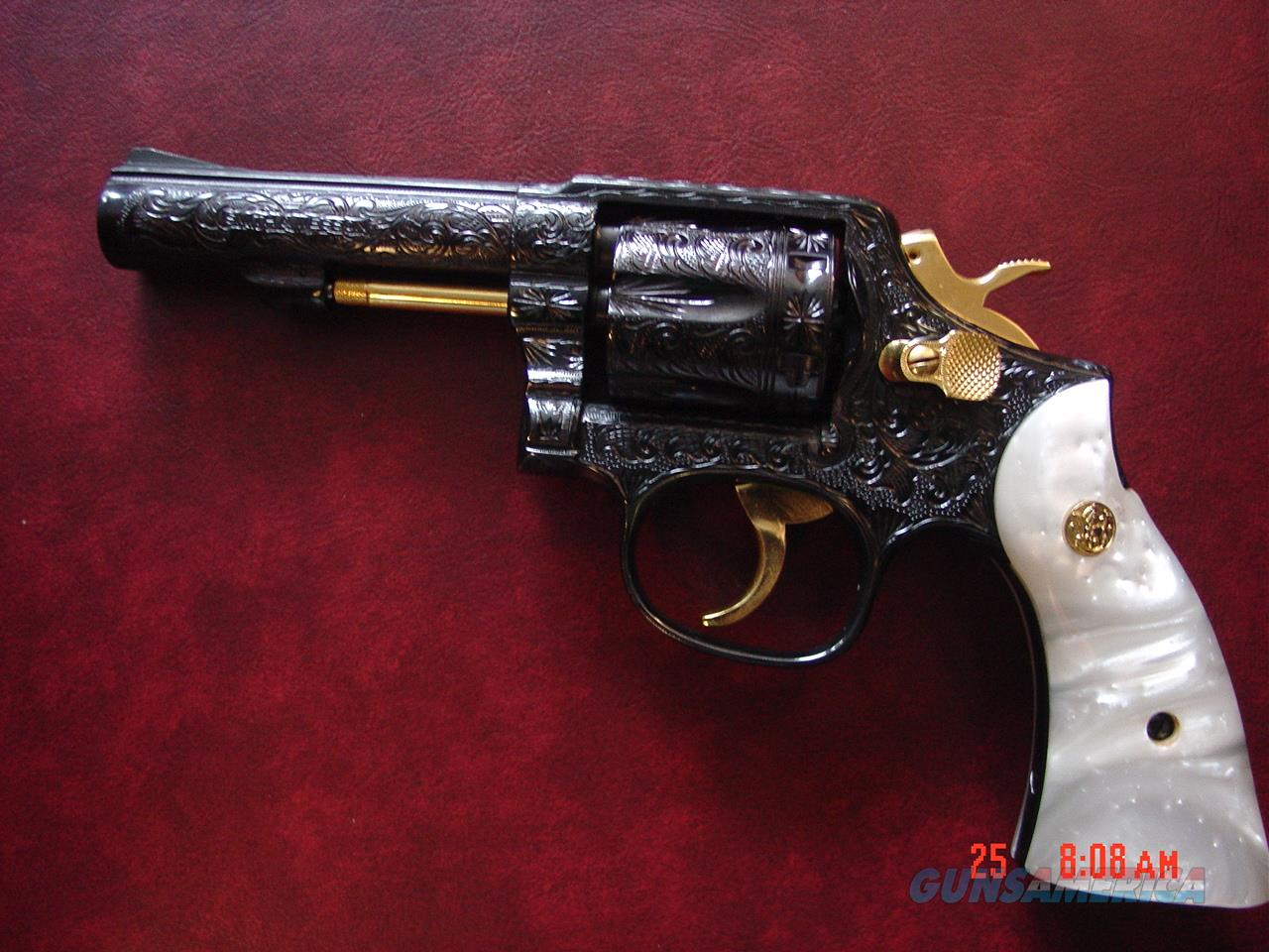 "Smith & Wesson model 10-8,4"",fully hand engraved & refinished in blue with gold,38spl,Pearlite grips,awesome showpiece-nicer in person by Flannery Engraving !!  Guns > Pistols > Smith & Wesson Revolvers > Model 10"
