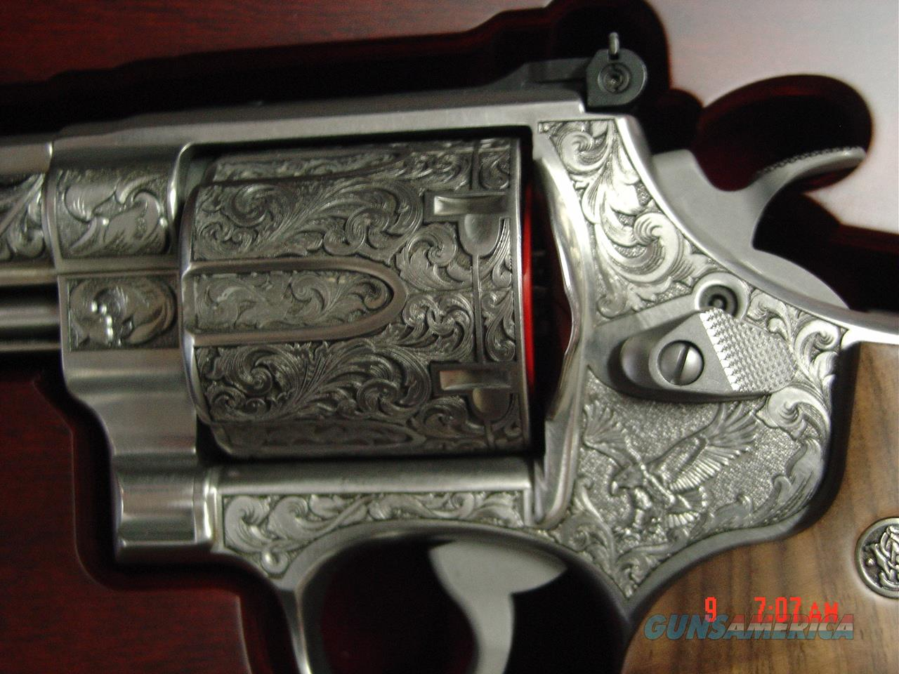 "Smith & Wesson 629-6, The Rising Eagle,fully deep relief engraved by Merlin Enright at Altamonte,6 1/2"",44 mag,carved walnut grips,fitted pres case. awesome engraving. # 200 of 300,& way nicer in person  Guns > Pistols > Smith & Wesson Revolvers > Model 629"
