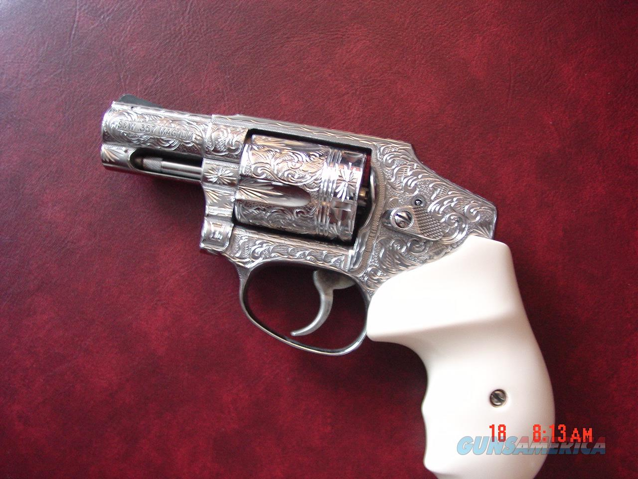 "Smith & Wesson 640-3,357 mag,2.125"",fully deep hand engraved & polished by Flannery Engraving,Bonded Ivory grips,certificate,box,manual & never fired !a true masterpiece !!  Guns > Pistols > Smith & Wesson Revolvers > Pocket Pistols"