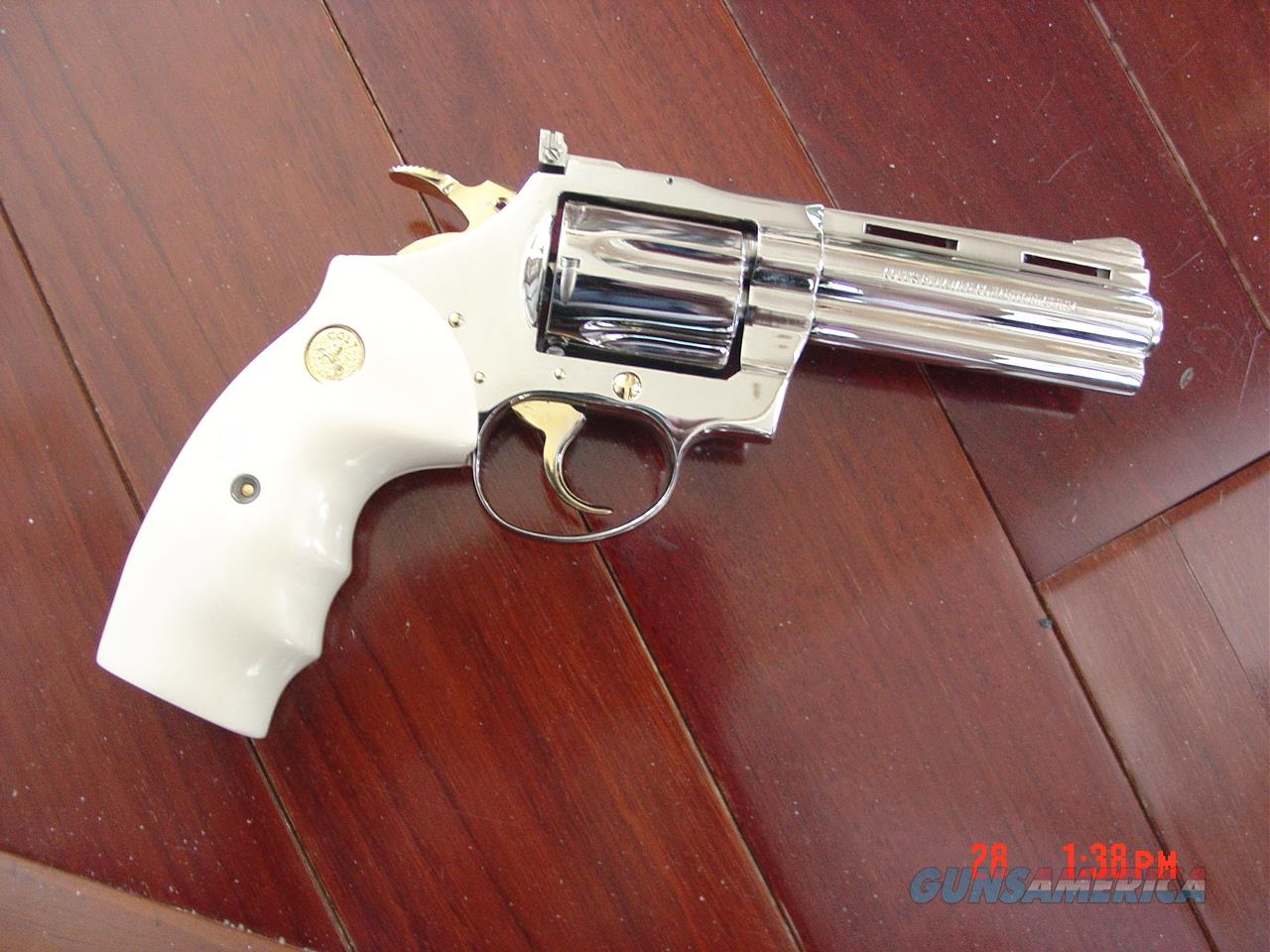 "Colt Diamondback 4"",38 spl,made in 1968,fully refinished in bright mirror nickel with 24k gold accents,bonded ivory grips,awesome showpiece  Guns > Pistols > Colt Double Action Revolvers- Modern"