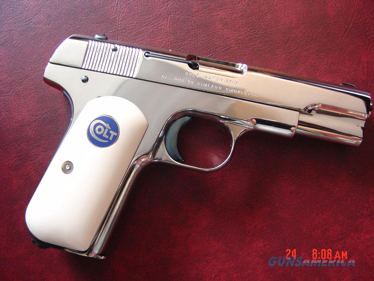 Colt 1903,32 auto,hammerless,fully refinished in bright mirror nickel, with fire blue accents,& bonded ivory grips, 103 years old !! a true showpiece !!  Guns > Pistols > Colt Automatic Pistols (.25, .32, & .380 cal)