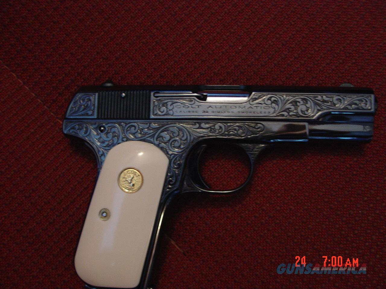 Colt 1903 hammerless, 32ACP, circa 1921,fully refinished in high gloss blue,& master engraved by S.Leis,with certificate,bonded ivory grips,1 of a kind work of art-nicer in person  Guns > Pistols > Colt Automatic Pistols (.25, .32, & .380 cal)