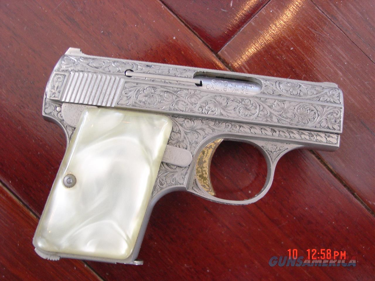 Browning Baby Renaissance 25ACP, factory engraved, French gray finish, Pearlite grips, made 1960's,getting rare now. Awesome engraving !!  Guns > Pistols > Browning Pistols > Baby Browning