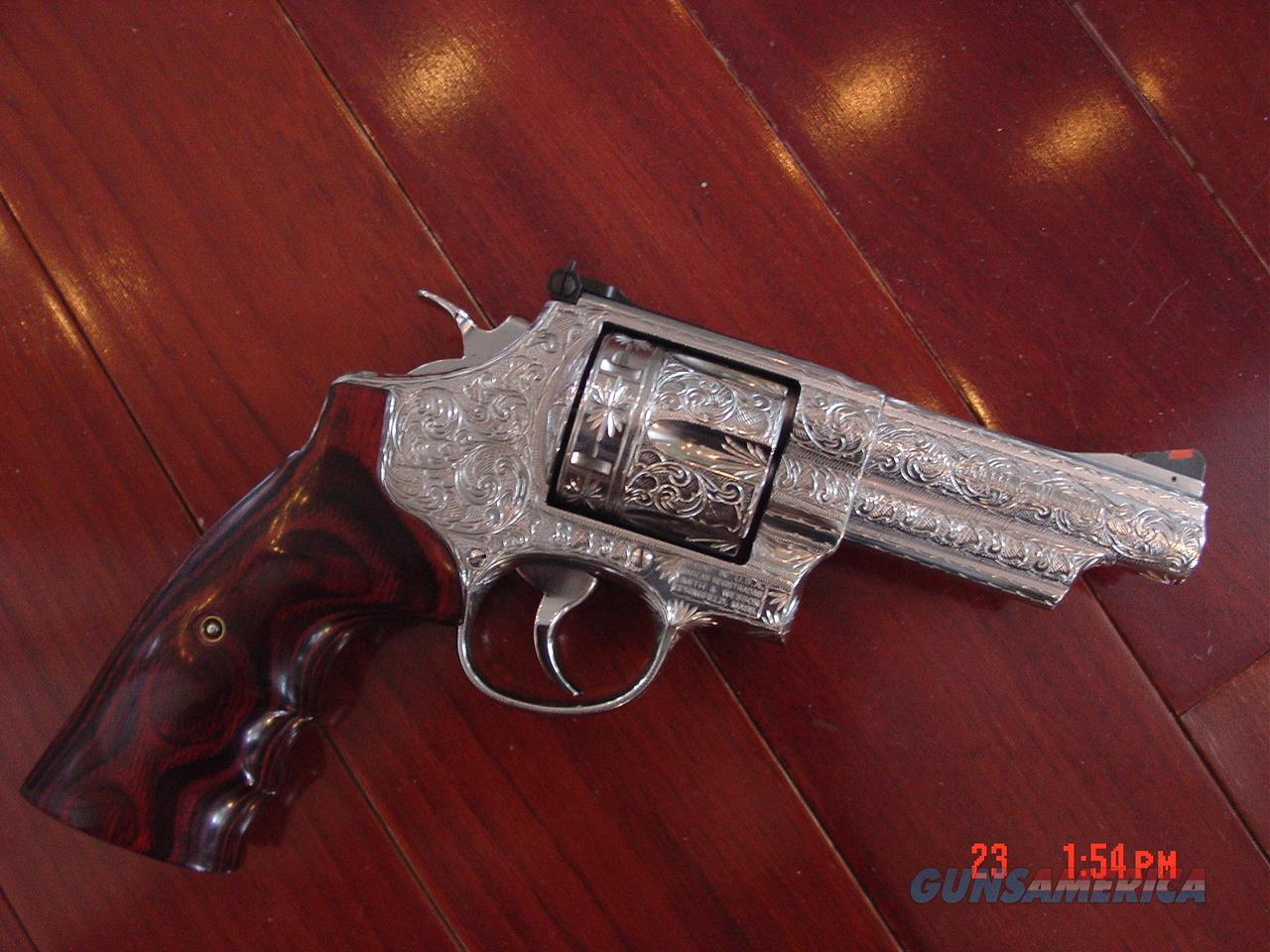 "Smith & Wesson 629-6,4"" 44 mag,fully deep hand engraved & polished by Flannery Engraving,Rosewood grips,all papers,awesome 1 of a kind masterpiece-nicer in person.  Guns > Pistols > Smith & Wesson Revolvers > Model 629"
