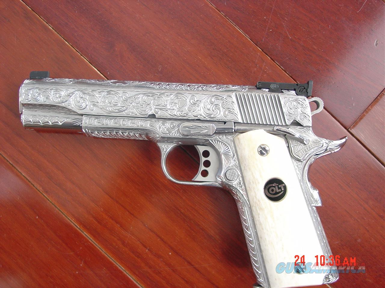 Colt Gold Cup Trophy 45,fully deep hand engraved by Flannery Engraving,real Giraffe bone grips,2 mags,certificate,etc.never fired. awesome 1 of a kind work of art !!  Guns > Pistols > Colt Automatic Pistols (1911 & Var)