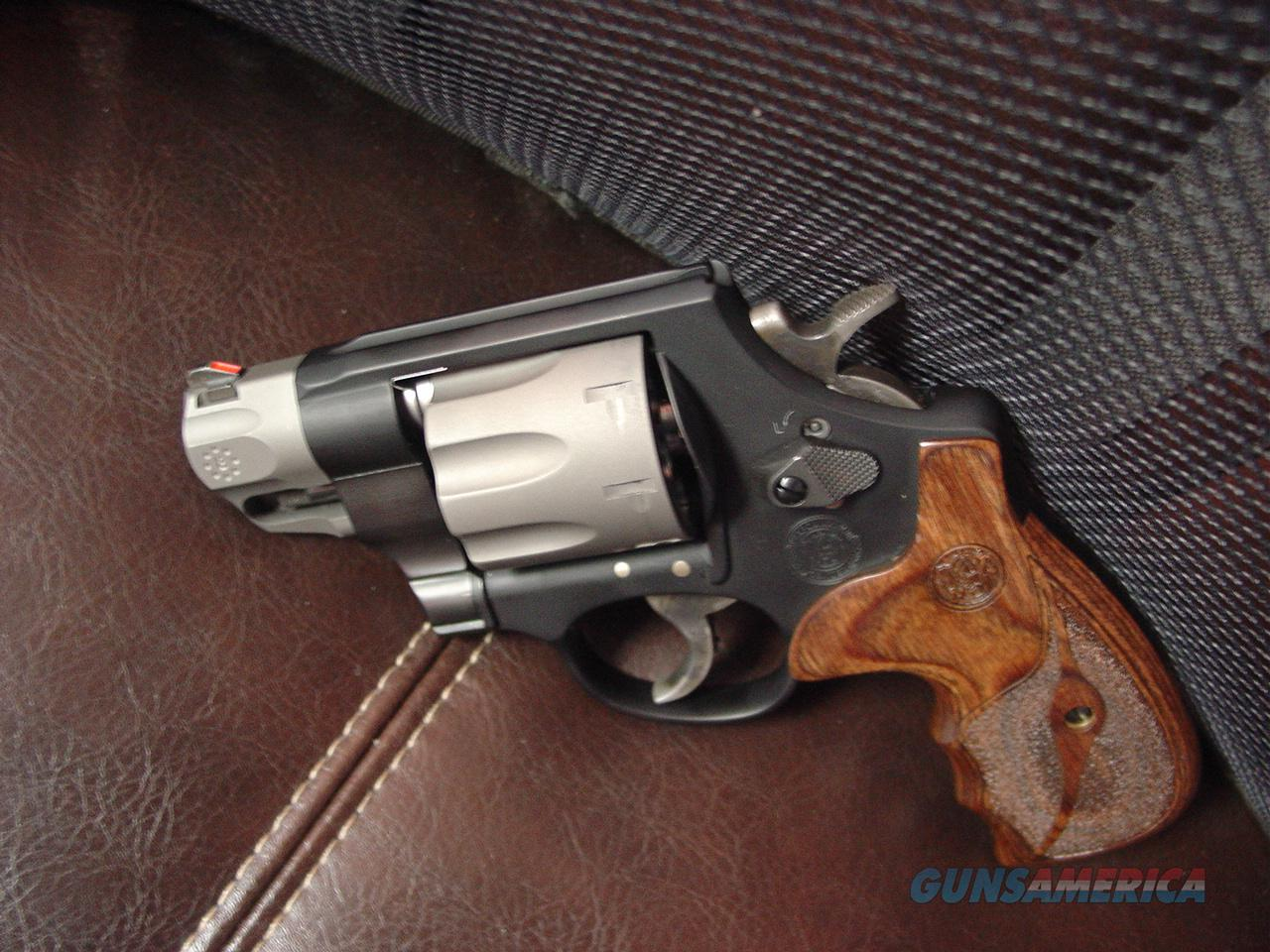 "Smith & Wesson model M327,8 shots,357 magnum,super light,Performance Center light trigger pull,beautiful wood grips,2"" barrel,2 tone finish,box & manual,as new,test fired-,super nice !!  Guns > Pistols > Smith & Wesson Revolvers > Performance Center"