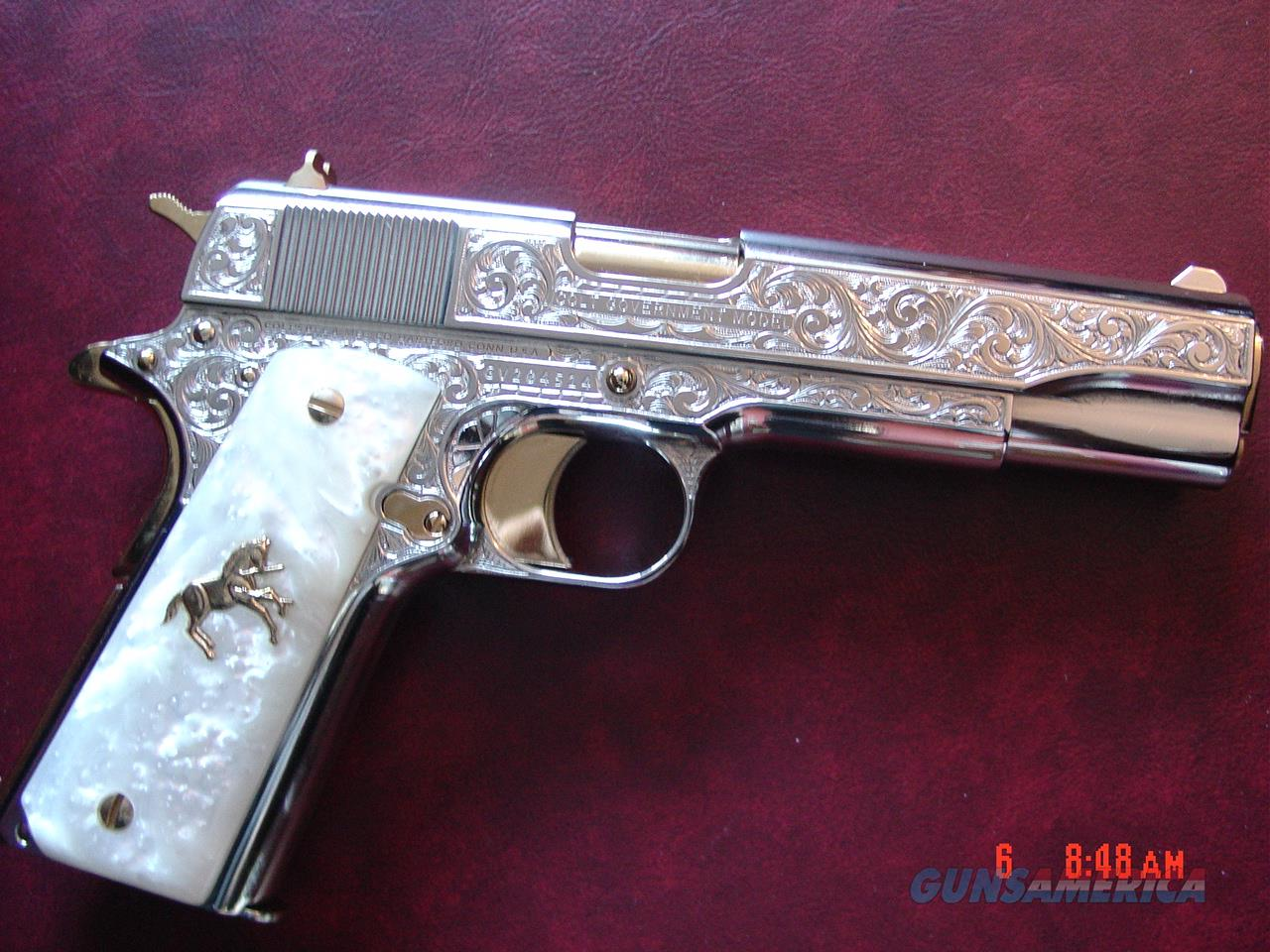 Colt Government 45,master engraved by S.Leis & refinished in bright nickel with 24K accents,Pearlite grips,never fired. a 1 of a kind work of art !!  Guns > Pistols > Colt Automatic Pistols (1911 & Var)