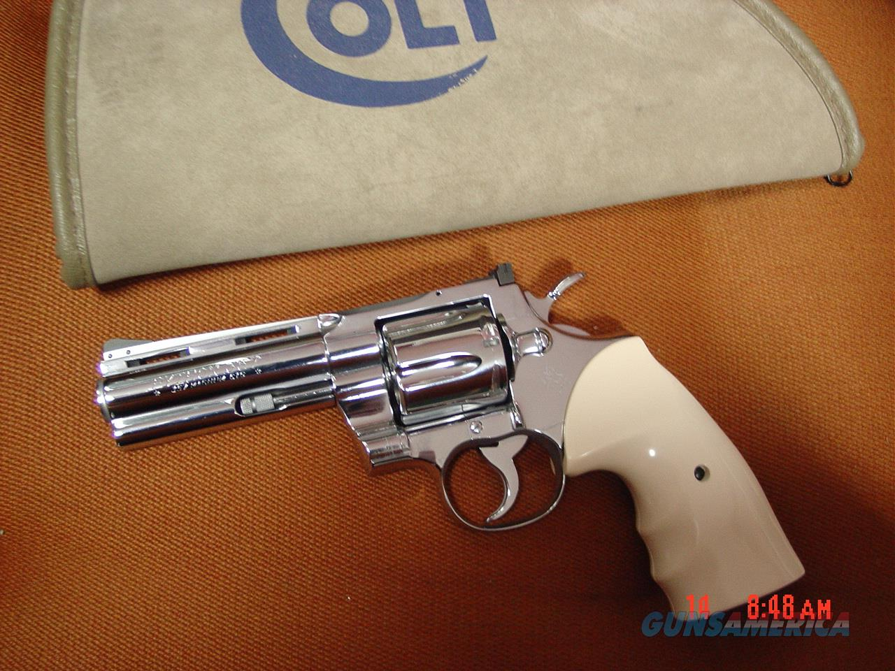 "Colt Python 1971, 4"" refinished nickel, bonded ivory grips,& custom wood grips,46 years old & looks awesome !!  Guns > Pistols > Colt Double Action Revolvers- Modern"