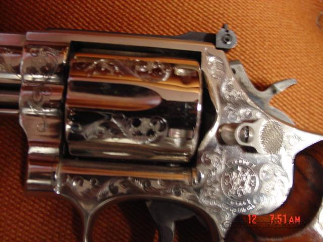 "Smith & Wesson Model 586 in rare nickel,deep scroll engraved,6""barrel,357 magnum/38 special.high polished,wood grips, made around 1980  Guns > Pistols > Smith & Wesson Revolvers > Full Frame Revolver"