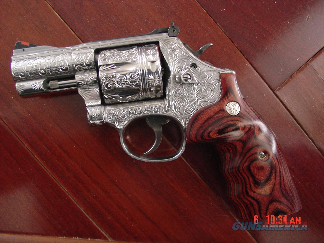 "Smith & Wesson 686-6 plus,7 shot,2 1/2"",fully deep hand engraved & polished by Flannery Engraving,Rosewood grips,certificate,box & manual-a real work of art 357 Mag.  Guns > Pistols > Smith & Wesson Revolvers > Full Frame Revolver"