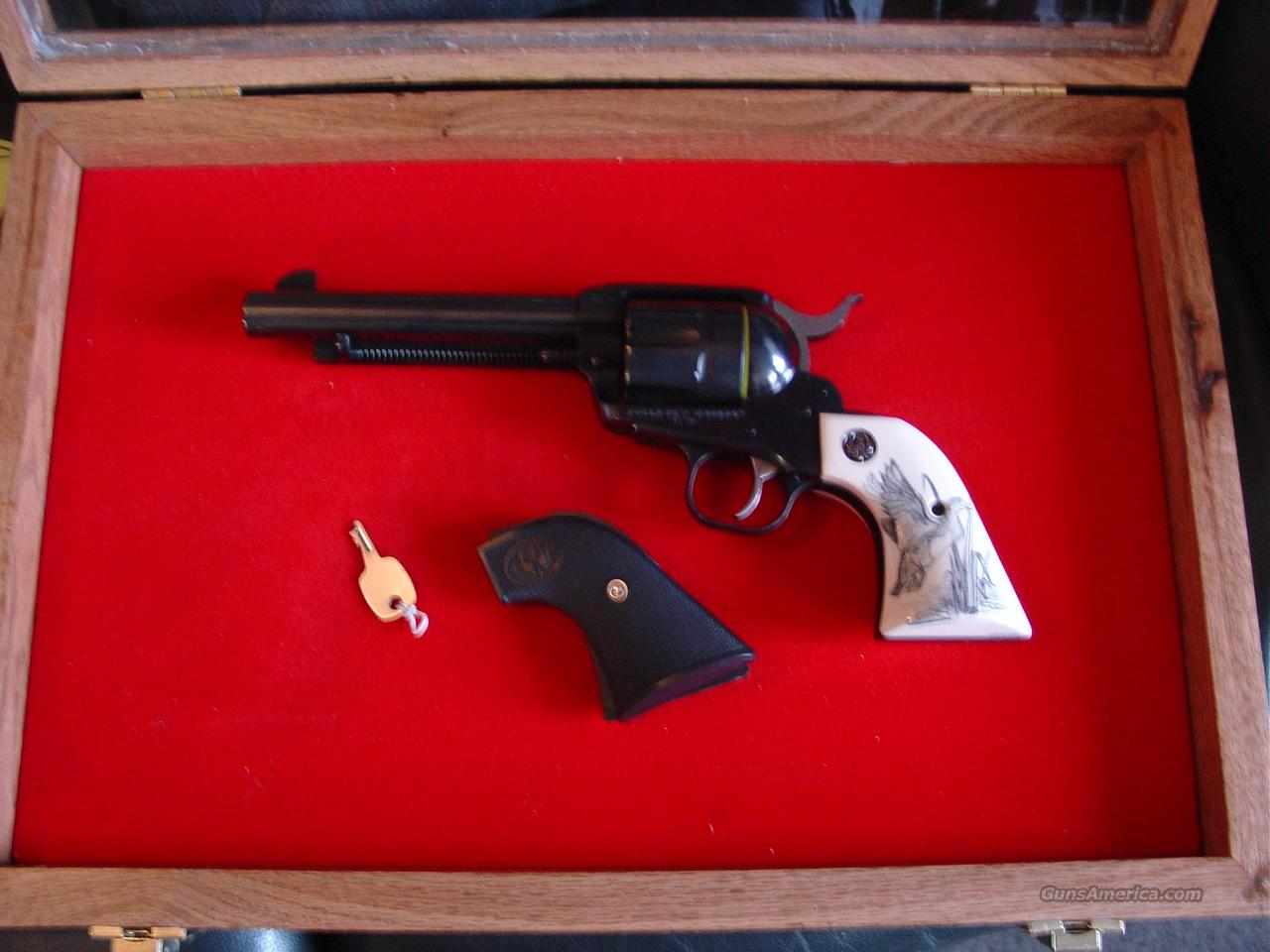 "Ruger New Vaquero,Ducks Unlimited 75th Anniversary,limited edition,45LC,5 1/2"",scrimshaw custom grips & regular grips,large engraved wood & glass pres case,original box & all papers,gold writing,never fired-awesome revolver.  Guns > Pistols > Ruger Single Action Revolvers > Cowboy Action"