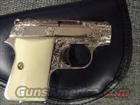 Colt Auto 25,nickel,fully engraved,REAL IVORY grips,made in 1970,nickel mag,#0D04253  Guns > Pistols > Colt Automatic Pistols (.25, .32, & .380 cal)