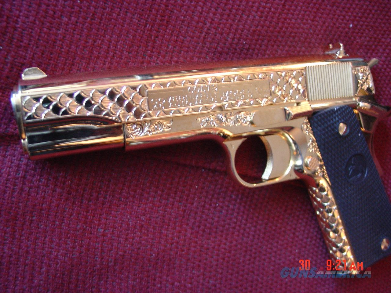 "Colt Government 45acp,5"",fully 24K gold plated,master deep scale engraved by Seattle Engraving Center,2 mags,box,papers,& never fired-a true work of art showpiece !! 1 of a kind !!  Guns > Pistols > Colt Automatic Pistols (1911 & Var)"