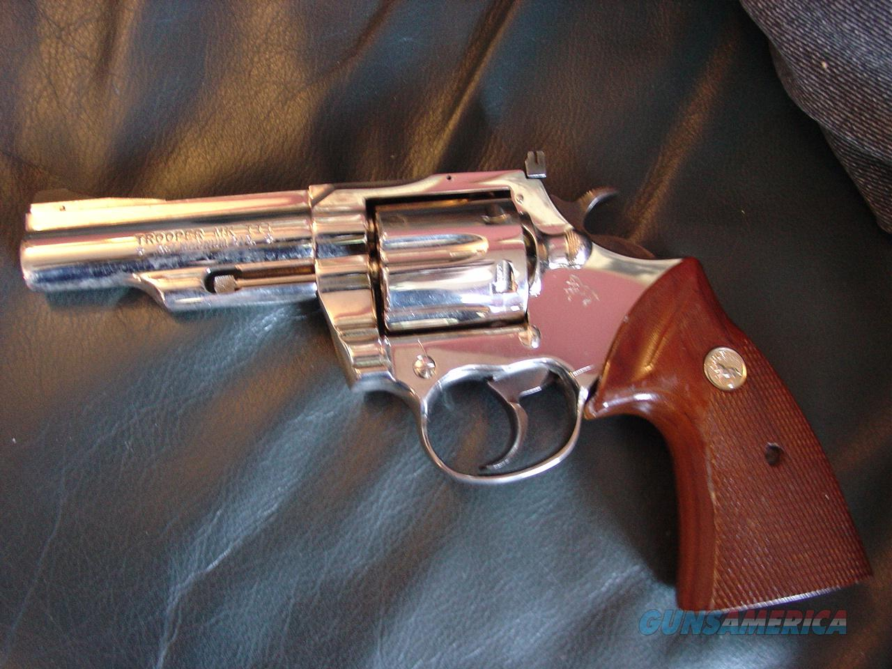 "Colt Trooper MK III,bright high polished nickel,4"",357magnum,Safariland leather holster,possibly around 1969,a real showpiece,wood grips,as nice as they get.  Guns > Pistols > Colt Double Action Revolvers- Modern"