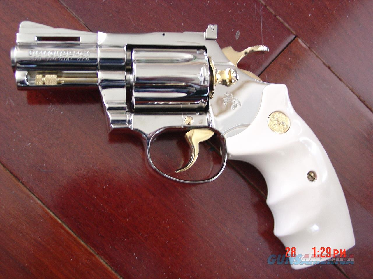 "Colt Diamondback,2 1/2""barrel,38 spl,1978,fully refinished in bright mirror nickel with 24K gold accents,bonded ivory grips,awesome showpiece !!  Guns > Pistols > Colt Double Action Revolvers- Modern"